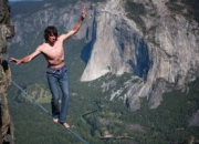 Dean Potter walks a tightrope in Yosemite at 7,800 feet